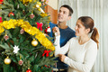 Happy couple decorating Christmas tree - PhotoDune Item for Sale