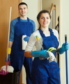 Smiling cleaners team at door - PhotoDune Item for Sale