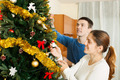 Couple decorating Christmas tree - PhotoDune Item for Sale