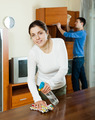 woman with husband cleaning wooden furiture - PhotoDune Item for Sale