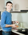 Handsome guy cooking frying squid - PhotoDune Item for Sale