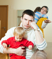 Young family conflict. Young upset  man against sadness woman - PhotoDune Item for Sale
