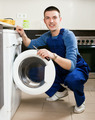 Repairman repairing washing machine - PhotoDune Item for Sale