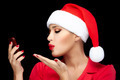 Christmas Woman in Santa Hat Taking a Selfie Sending Kisses - PhotoDune Item for Sale