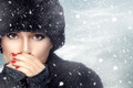 Winter Beauty Fashion. Girl in Warm Clothes on a Snowstorm - PhotoDune Item for Sale
