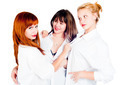 Three young beautiful women in white shirts. Isolated over white - PhotoDune Item for Sale