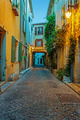 Narrow street in the old town Antibes in France. Night view - PhotoDune Item for Sale