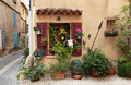Facade of old French house and potted flowers - PhotoDune Item for Sale