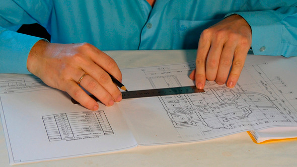 Architect Working With Blueprint