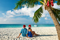 Couple in blue clothes on a beach at christmas - PhotoDune Item for Sale
