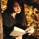 Girl Reading Book In Autumn Park - VideoHive Item for Sale
