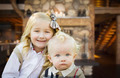Cute Young Brother and Sister Pose In Rustic Cabin. - PhotoDune Item for Sale