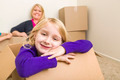 Happy Young Mother and Daughter Having Fun With Moving Boxes. - PhotoDune Item for Sale