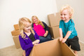 Playful Young Family In Empty Room Playing With Moving Boxes. - PhotoDune Item for Sale