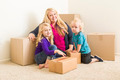 Happy Young Family in Empty Room With Moving Boxes. - PhotoDune Item for Sale