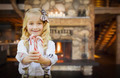 Cute Happy Young Girl Holding Candy Canes in Rustic Cabin. - PhotoDune Item for Sale