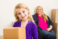 Happy Young Mother and Daughter In Empty Room With Moving Boxes. - PhotoDune Item for Sale