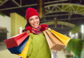 Pretty Warmly Dressed Mixed Race Woman In Outdoor Mall with Shopping Bags. - PhotoDune Item for Sale