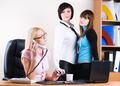 Attractive businesswomen in office - PhotoDune Item for Sale