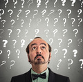 businessman with many questions