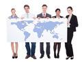 Portrait Of Confident Businesspeople Holding Worldmap - PhotoDune Item for Sale