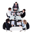 Businesspeople Discussing Over Graphs At Conference Table - PhotoDune Item for Sale