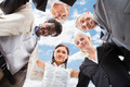 Multiethnic Business People Forming Huddle Against Sky - PhotoDune Item for Sale