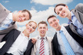 Happy Businesspeople Making Huddle Against Sky - PhotoDune Item for Sale