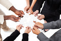 Business People's Hands Solving Jigsaw Puzzle - PhotoDune Item for Sale