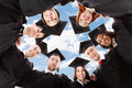 Happy Multiethnic Graduates Forming Huddle Against Sky - PhotoDune Item for Sale