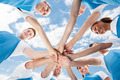 Professional Cleaners Piling Hands Against Sky - PhotoDune Item for Sale