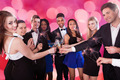 Friends Holding Sparklers While Toasting Drinks At Nightclub - PhotoDune Item for Sale
