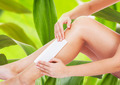 Woman Waxing Leg Against Leaves - PhotoDune Item for Sale