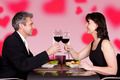 Couple Toasting Wineglasses At Table In Restaurant - PhotoDune Item for Sale