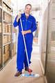 Smiling Worker Cleaning Warehouse With Mop - PhotoDune Item for Sale