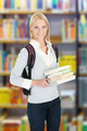 Female College Student Holding Books In Library - PhotoDune Item for Sale