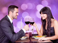 Happy Young Couple Toasting Wineglasses At Restaurant Table - PhotoDune Item for Sale