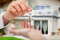 Real Estate Agent Giving Keys To Owner Against New House - PhotoDune Item for Sale