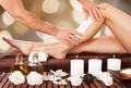 Male Beautician Waxing Woman's Leg In Spa - PhotoDune Item for Sale