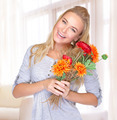 Cheerful female with flowers - PhotoDune Item for Sale