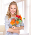 Happy woman with autumn flowers - PhotoDune Item for Sale