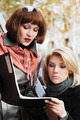 Two young fashion business women with a folder - PhotoDune Item for Sale