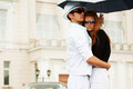 Young fashion couple in love with umbrella - PhotoDune Item for Sale