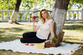 Young fashion woman with apple in a city park - PhotoDune Item for Sale