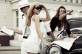 Young fashion people with a road map at the retro car - PhotoDune Item for Sale