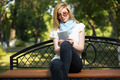 Young fashion woman using tablet computer in a city park - PhotoDune Item for Sale