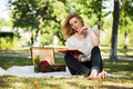 Young fashion woman reading a book in a city park - PhotoDune Item for Sale