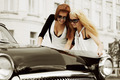 Young fashion women with a road map at the retro car - PhotoDune Item for Sale