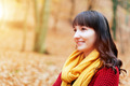 Pretty woman in red sweater smiling in fall autumn park - PhotoDune Item for Sale