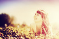 Young beautiful woman lying on grass full of spring flowers. Vintage style. - PhotoDune Item for Sale